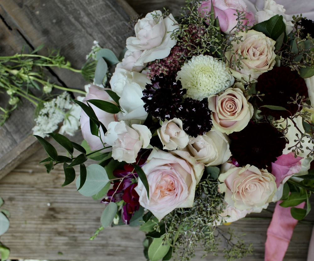 white and pink petaled flower bouquet