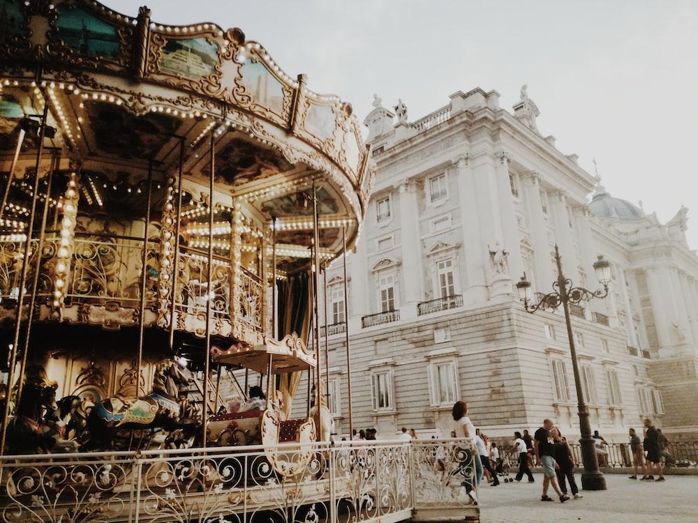 brown carousel beside building