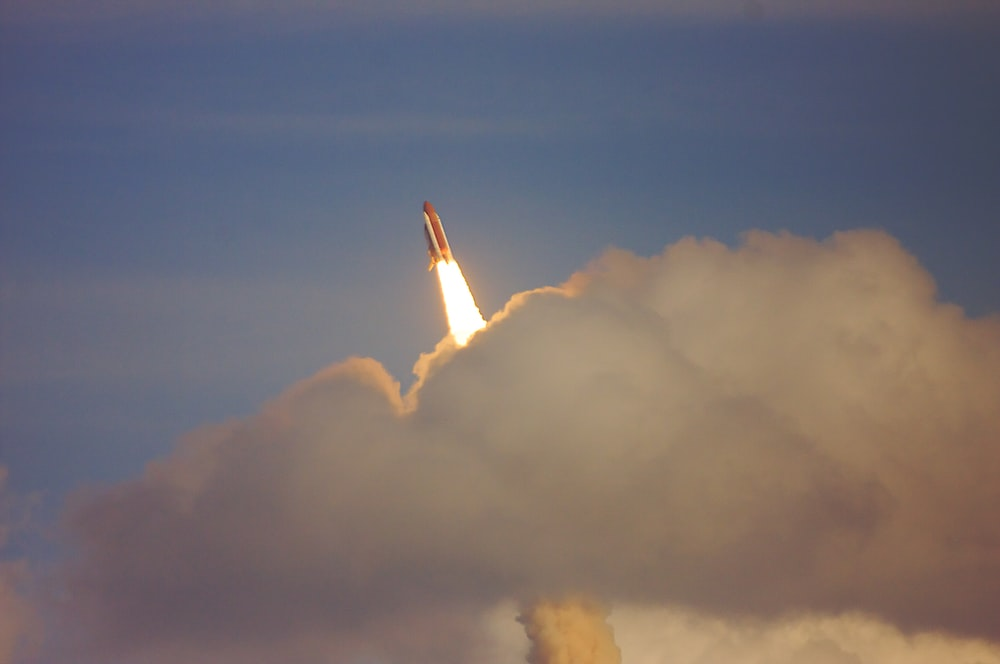 low-angle photography of red space shuttle