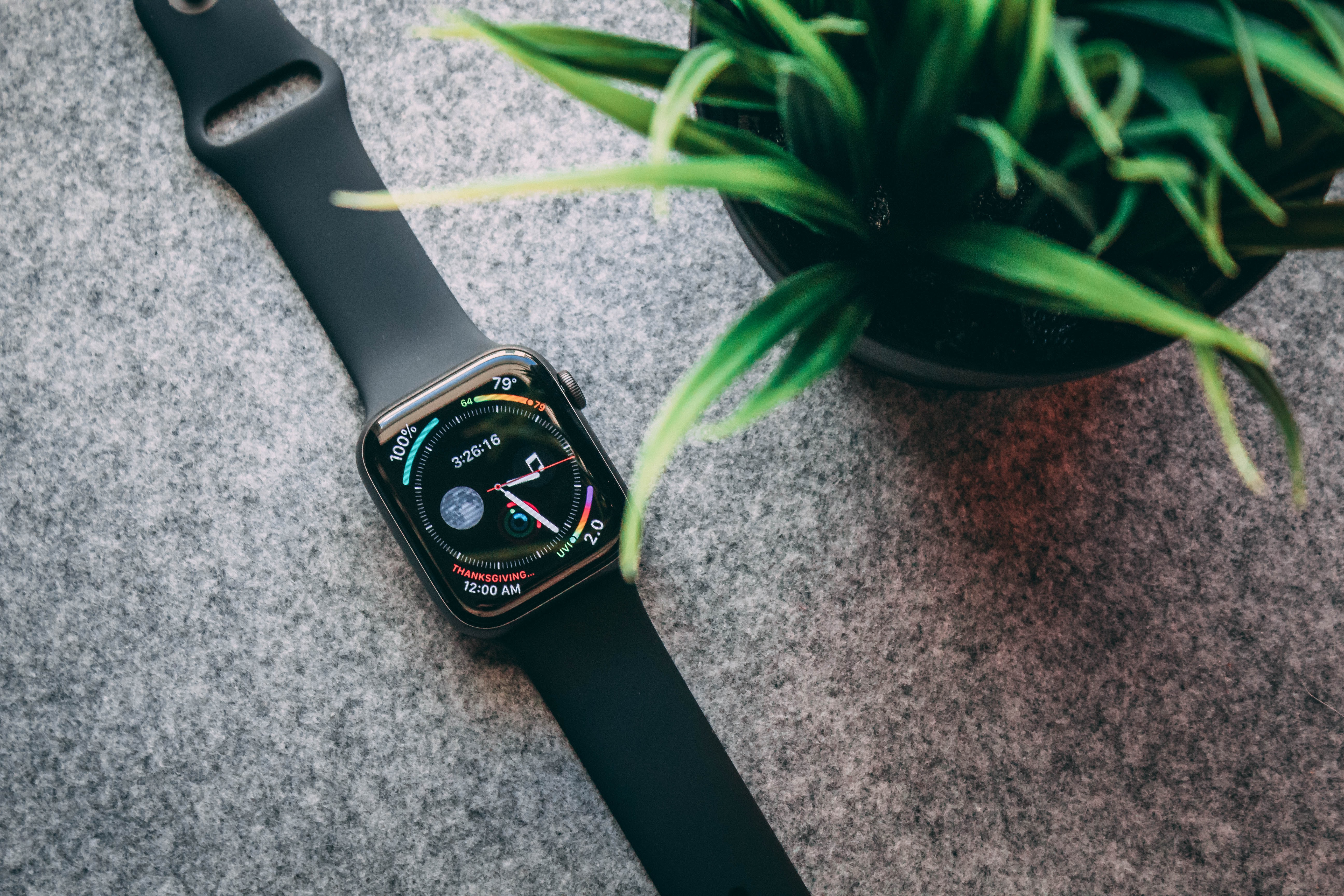 black and green analog watch