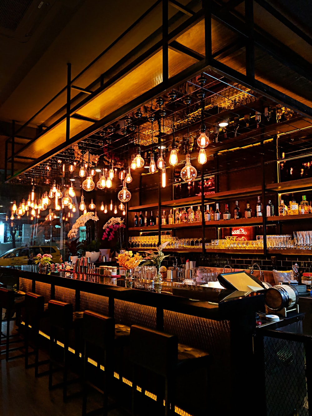 turned-on filament bulb lights at bar counter
