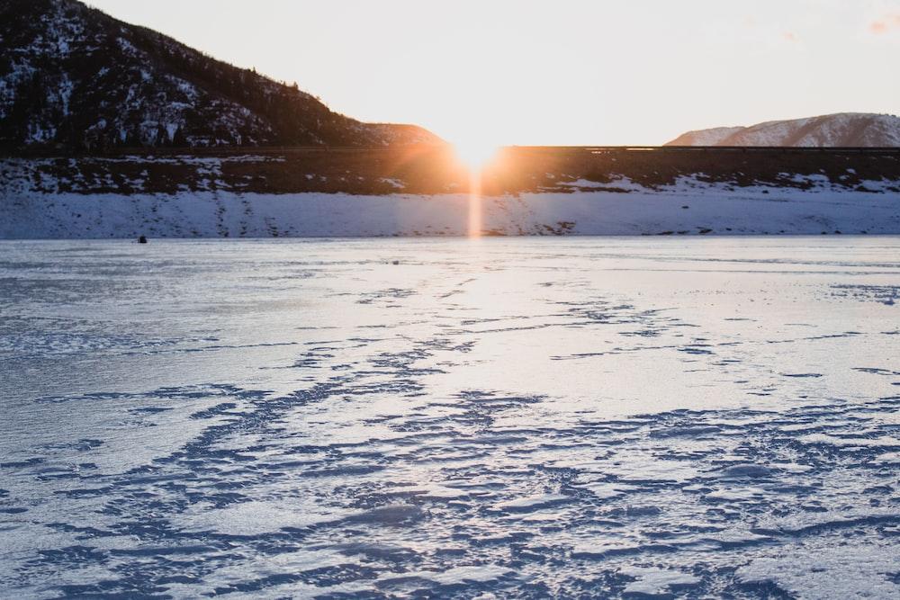 snow terrain in sunrise background