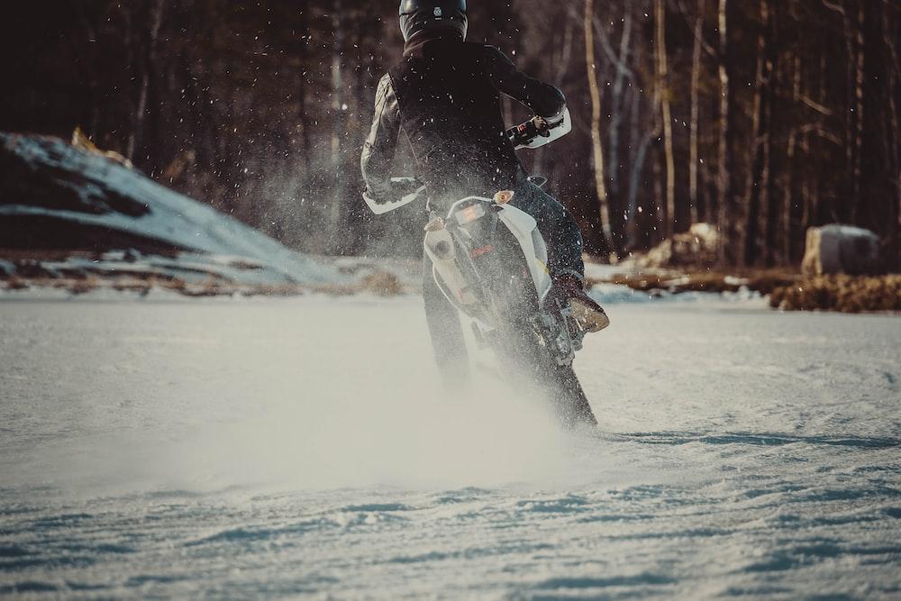 man riding motorcycle on snow