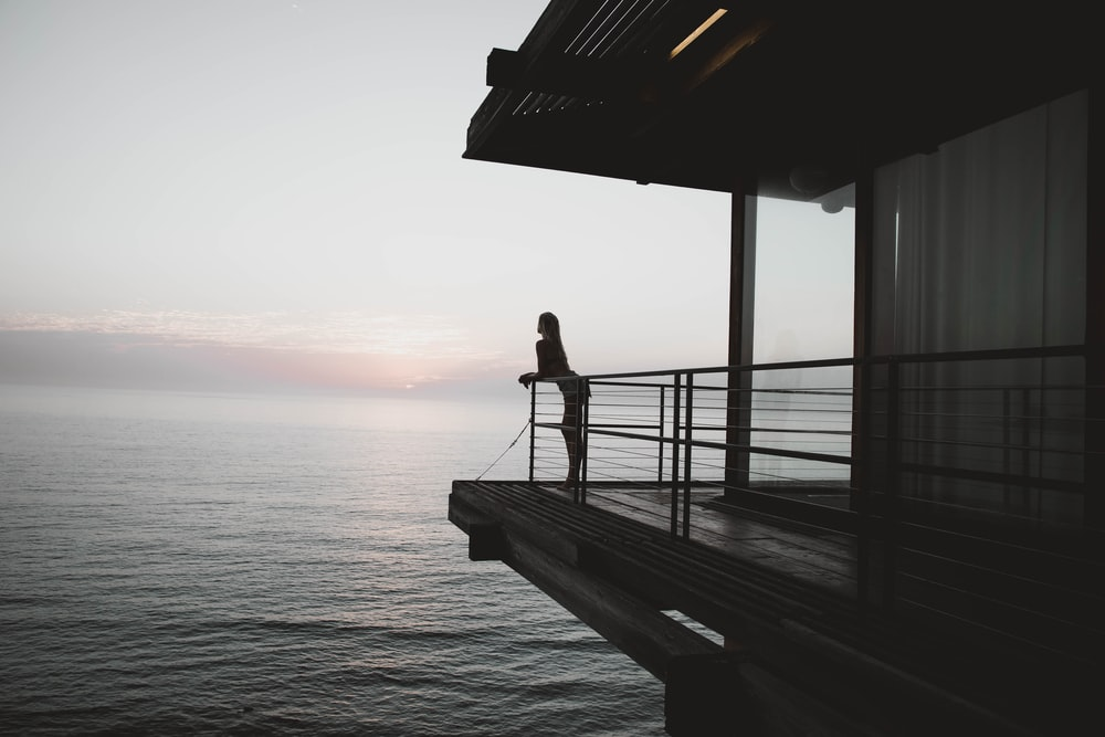 silhoette of woman standing on deck