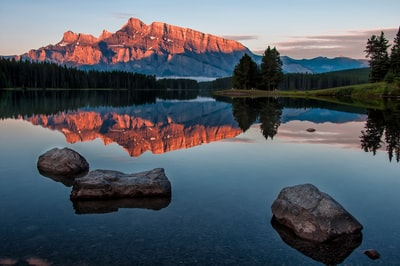 mountain reflection on body of water outdoor teams background