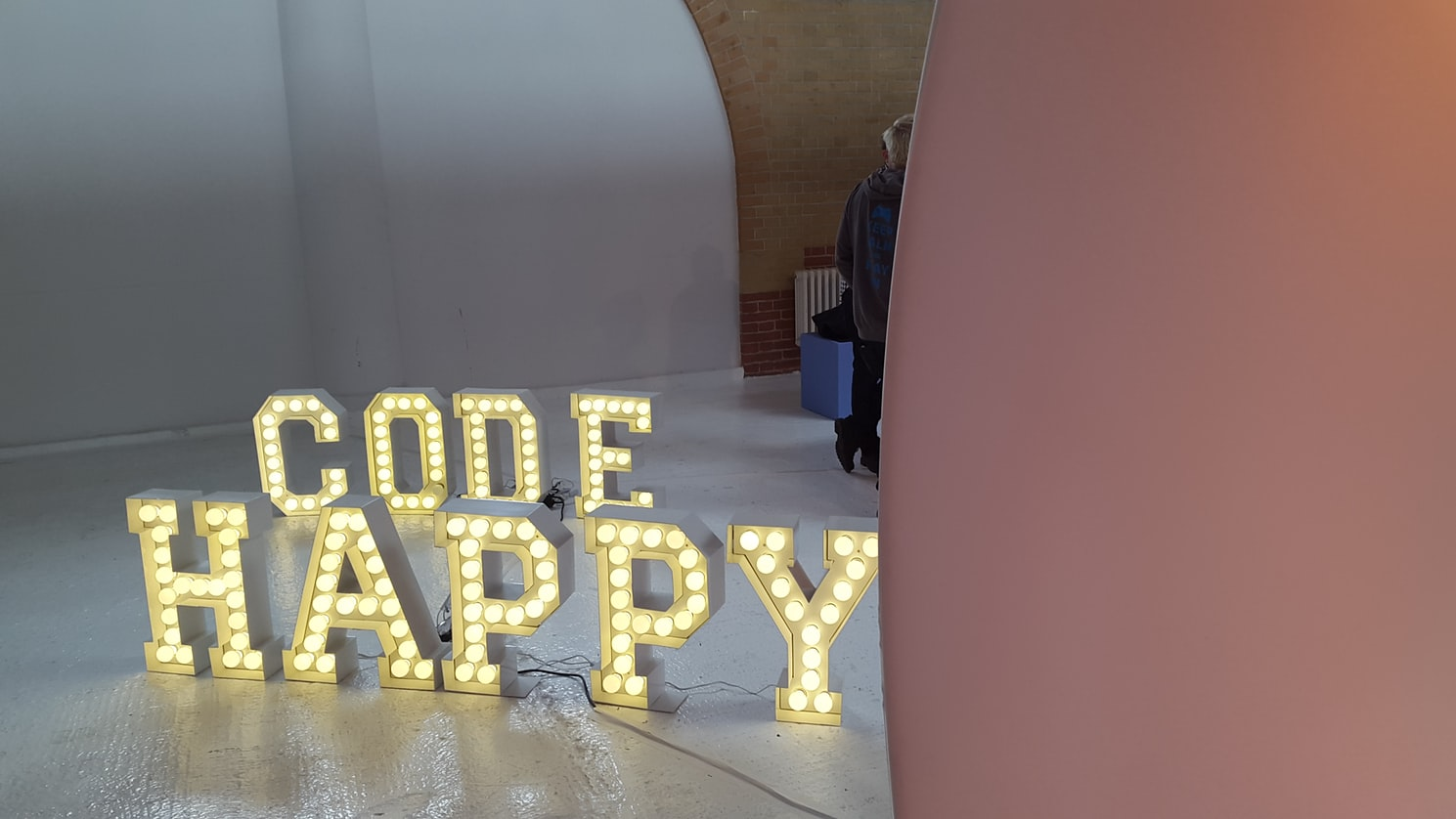 two sets of brown Code Happy marquee lights