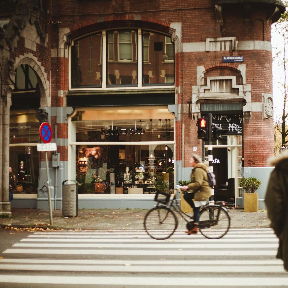 woman riding bike on pedestrian lane