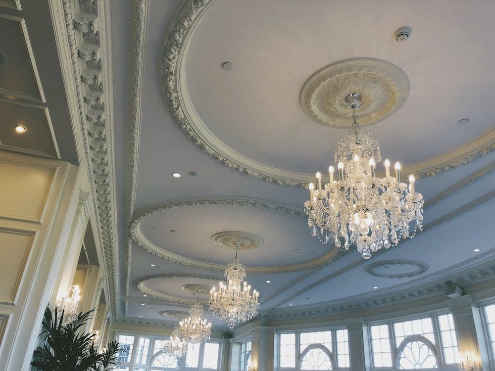 glass chandeliers in room