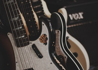 brown and black bass guitars