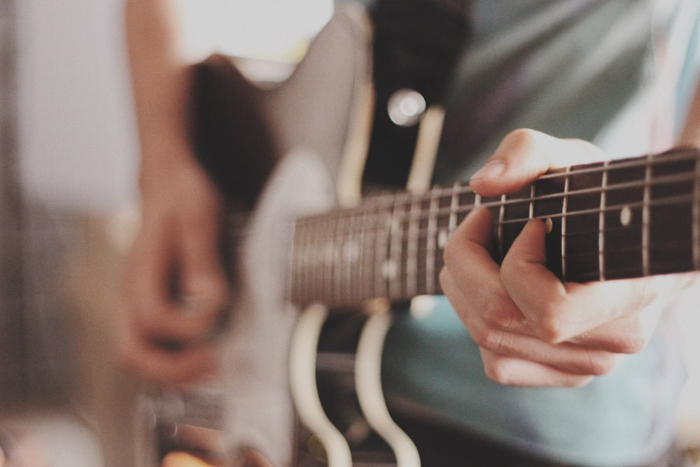 person playing electric guitar
