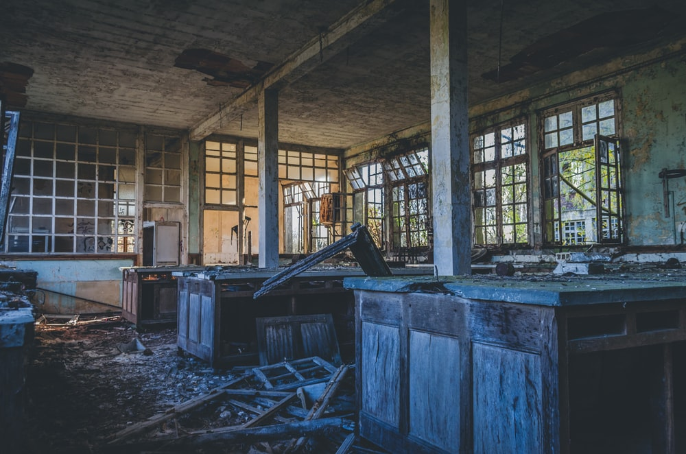 abandoned kitchen area during daytime