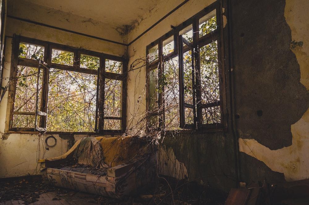 wooden chair near the windows
