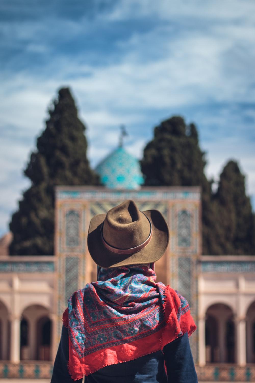 woman wearing brown cowboy hat