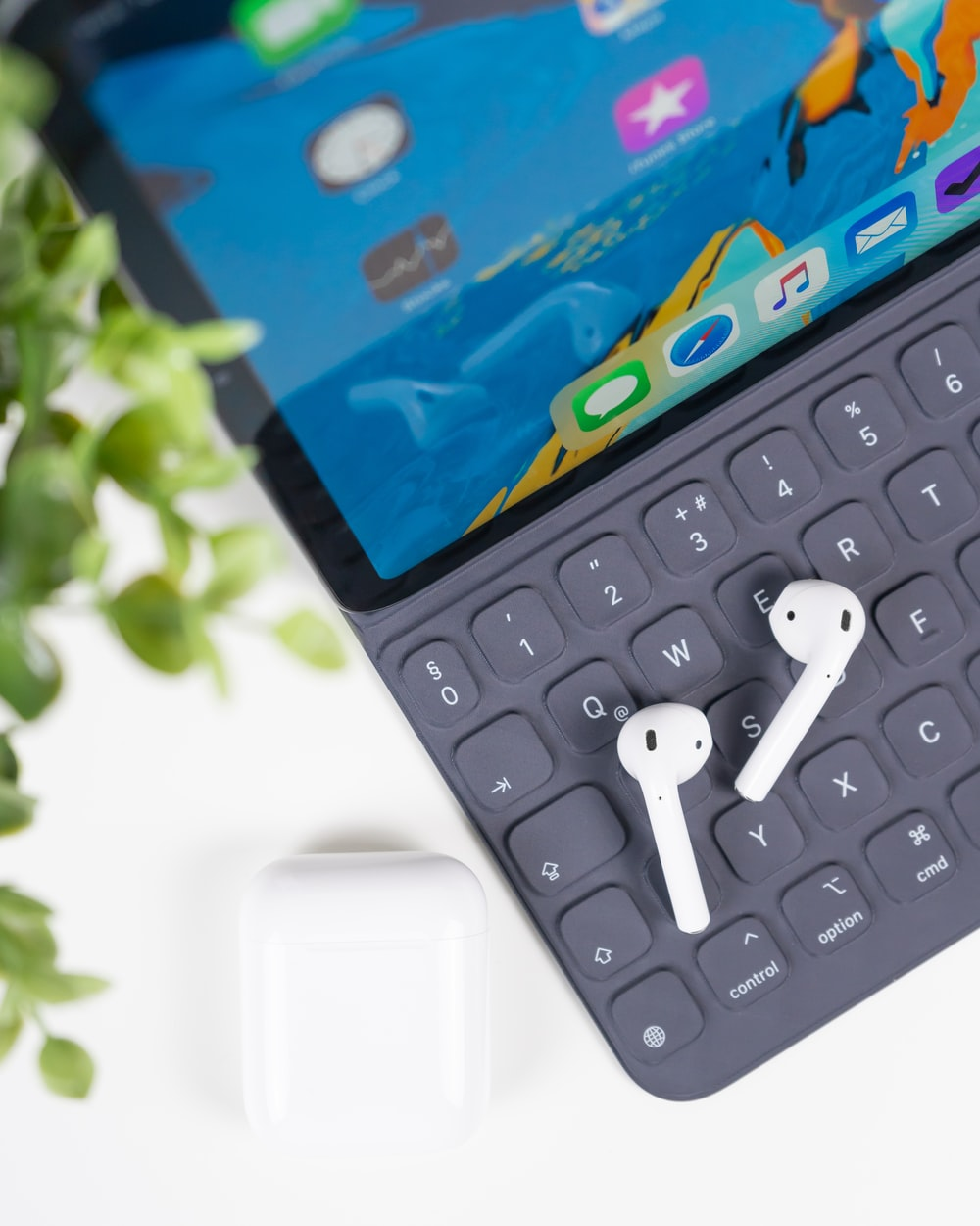 space gray iPad Pro with Apple AirPods