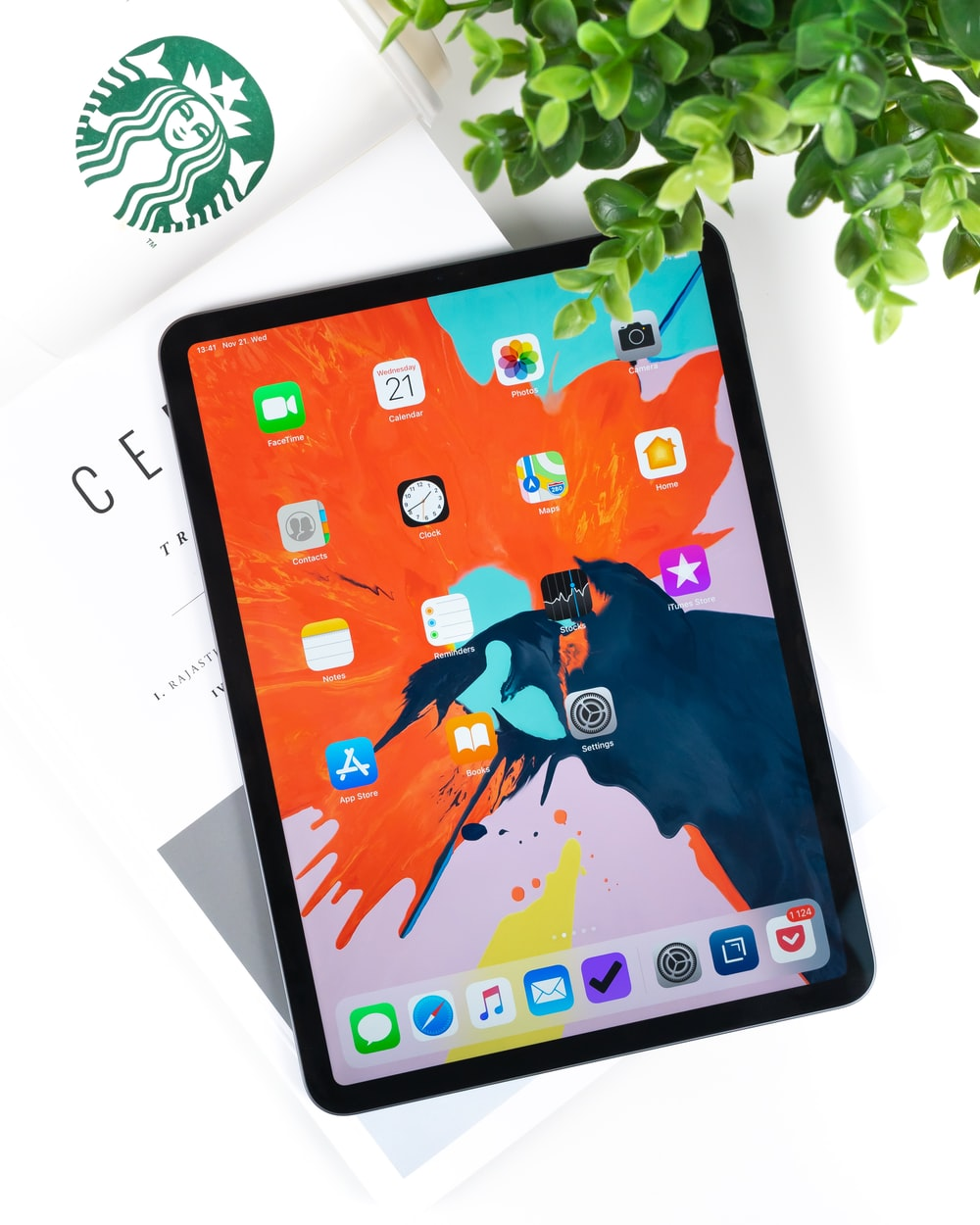 space gray iPad Pro on top of book