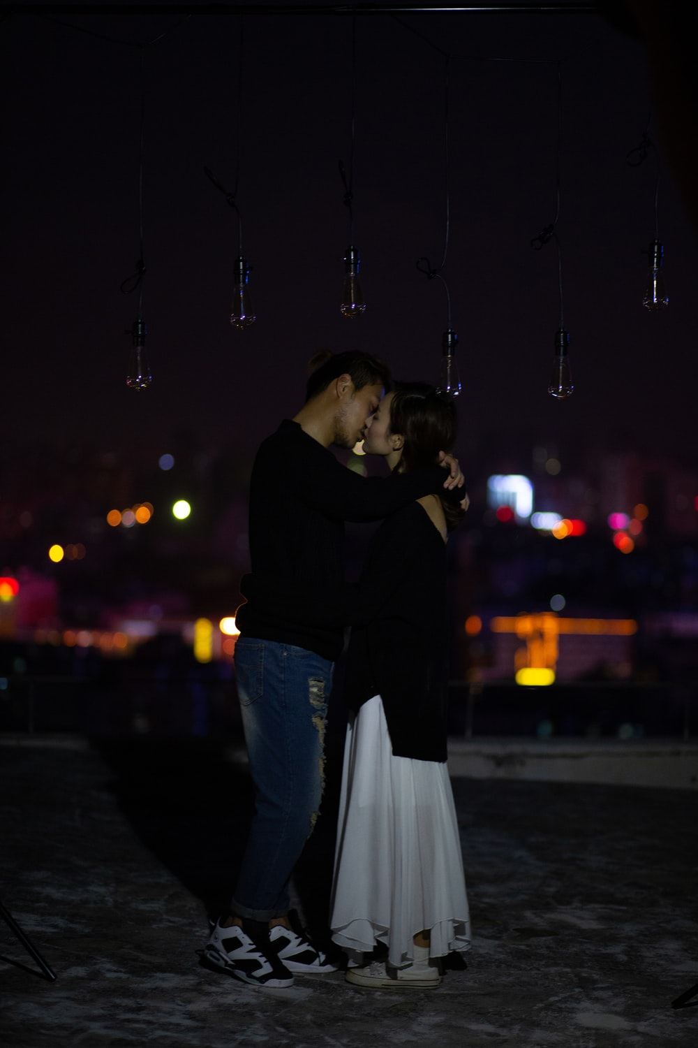 couple kissing at night
