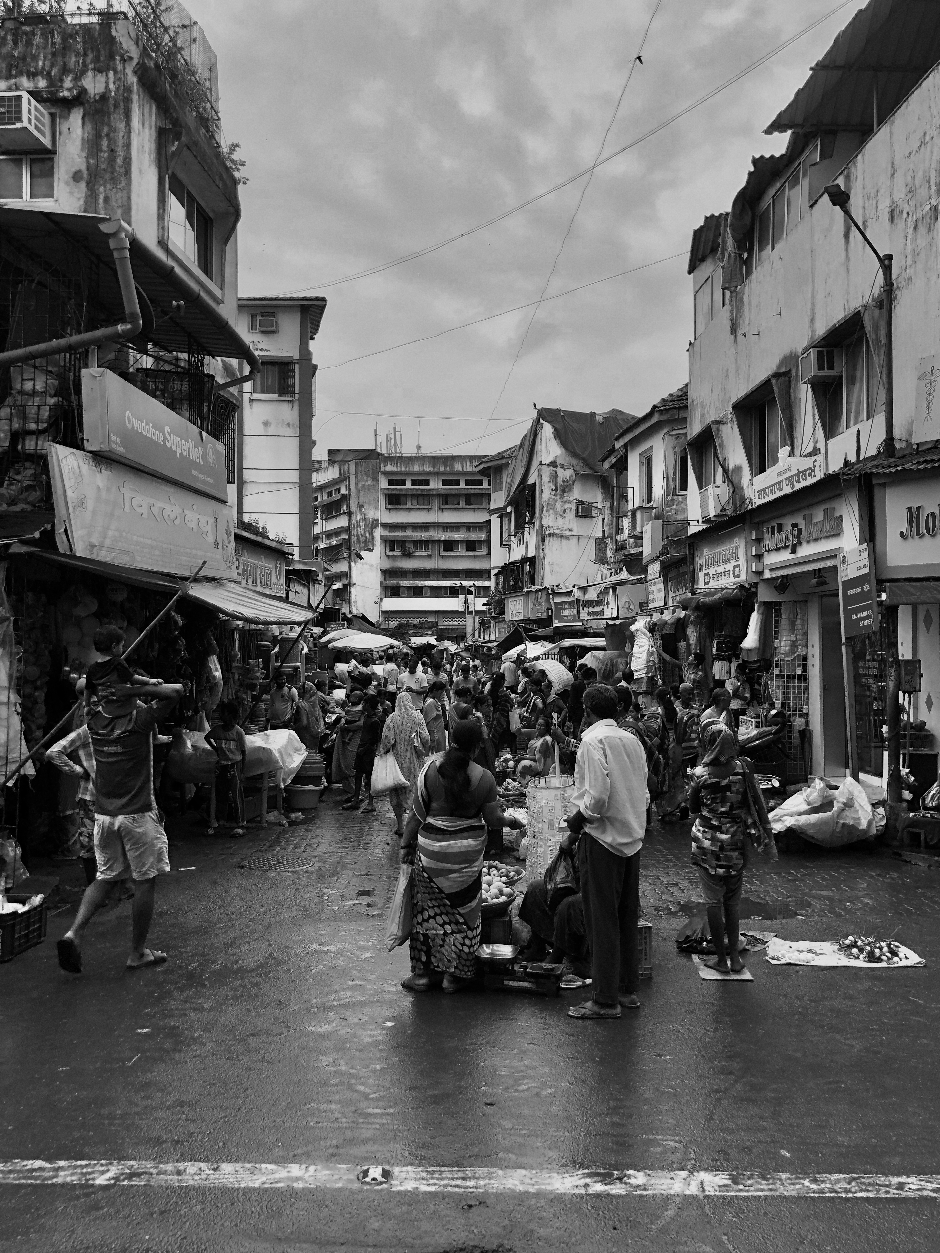 Walking through a rain drenched market in Mumbai, the melancholy and wet mood made for a perfect monochromatic shot.