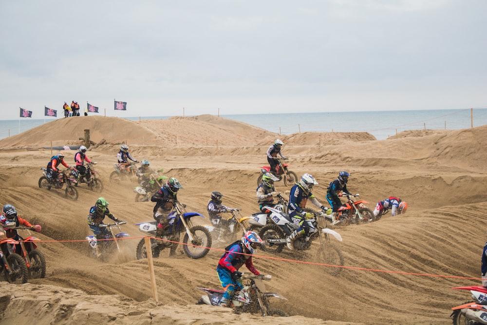 people riding dirt bike during daytime