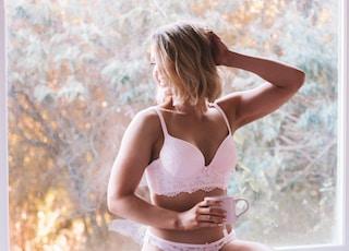 woman wearing pink underwire bra and panties