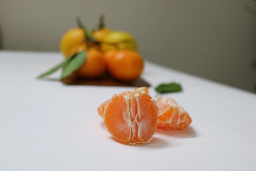 peeled orange fruit shallow focus photography