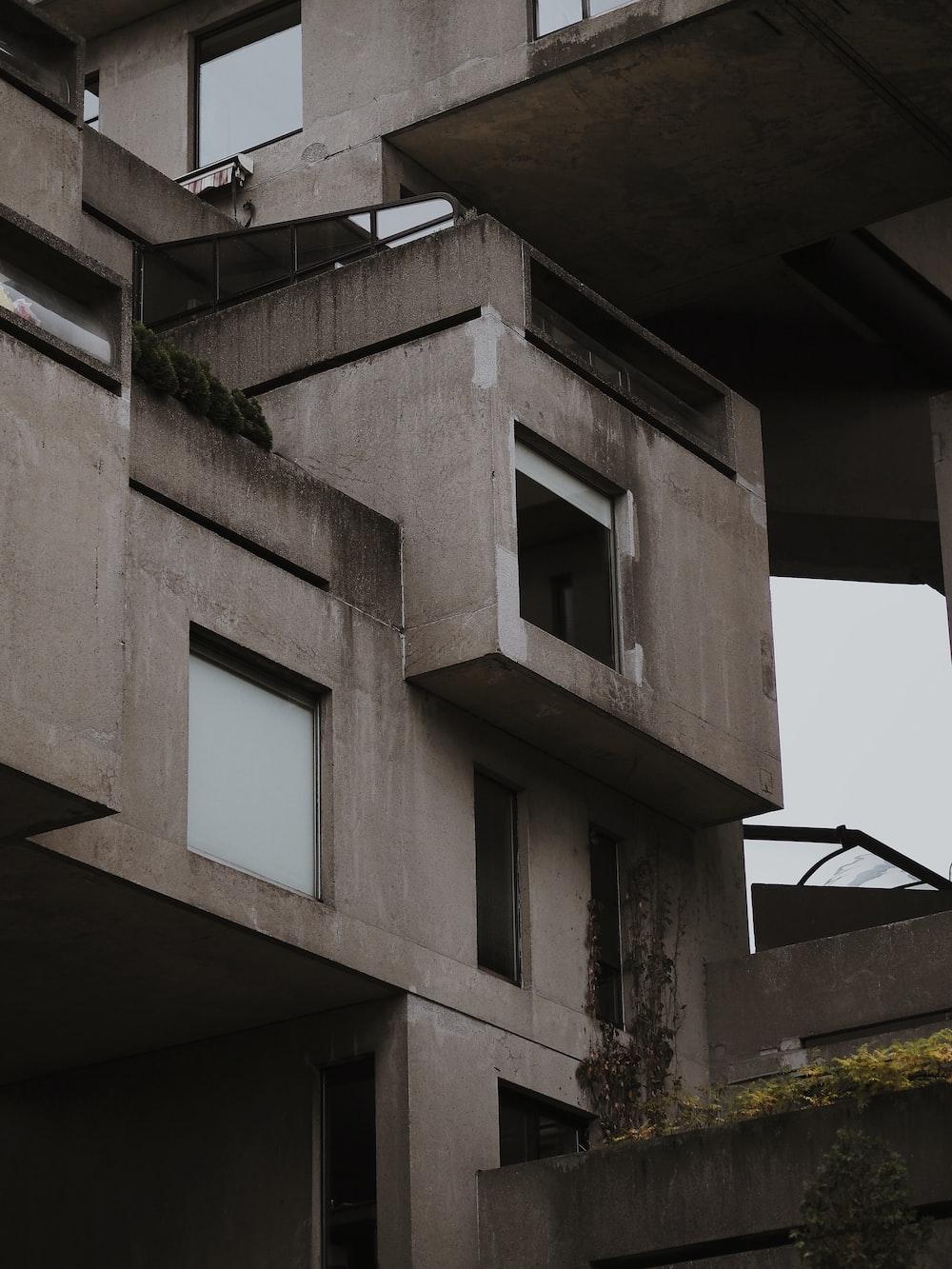 gray concrete multi story building
