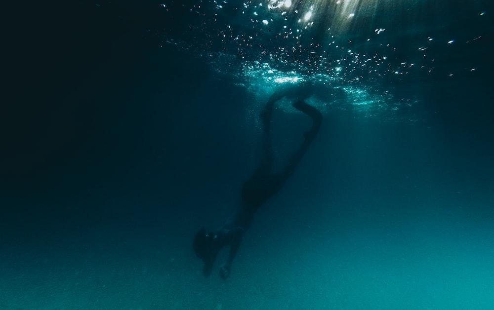 person underwater photo