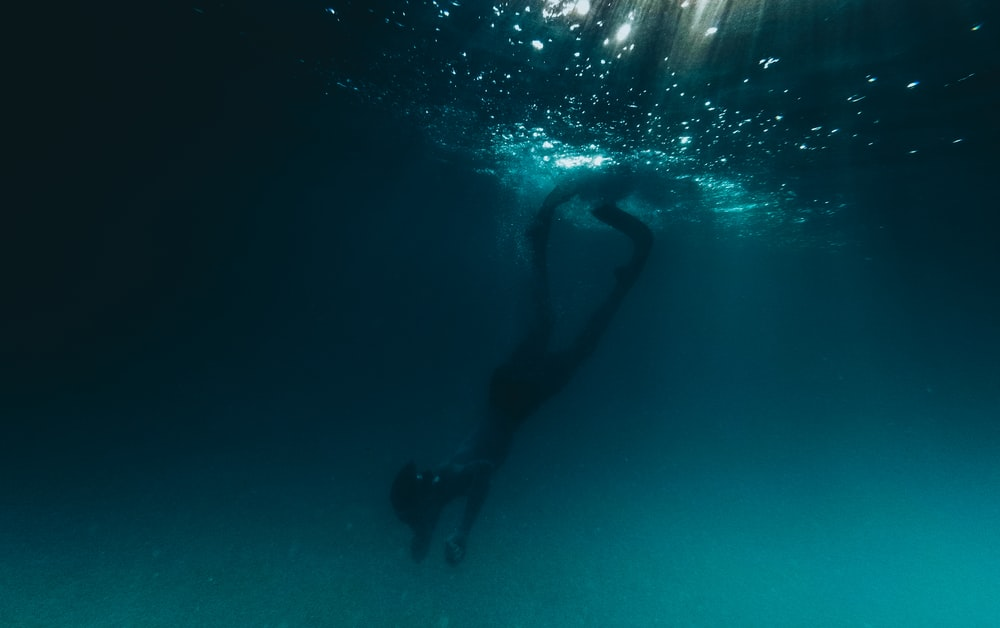 person underwater photo