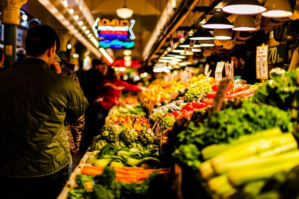 man walking beside vegetables