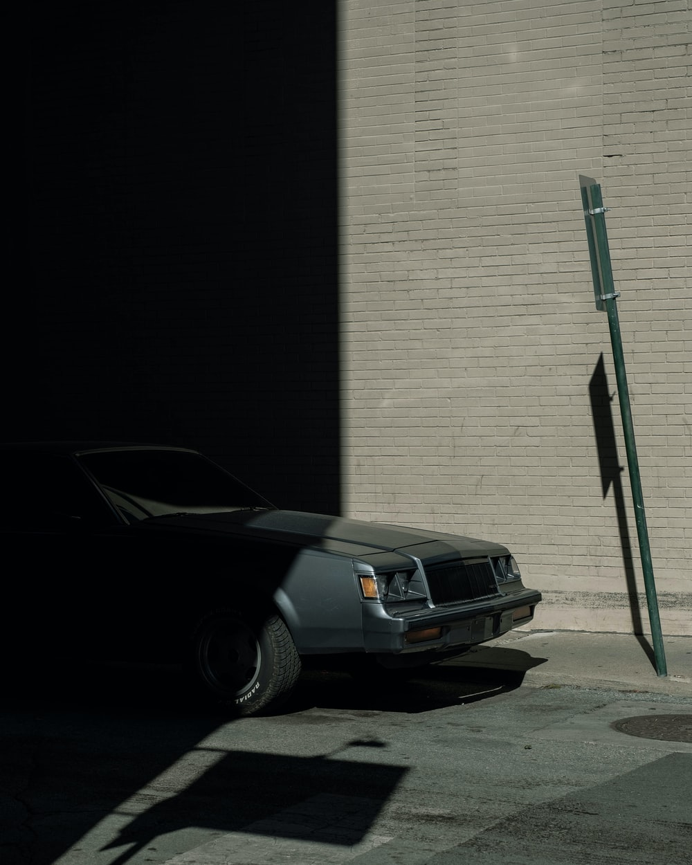 gray vehicle parked near building