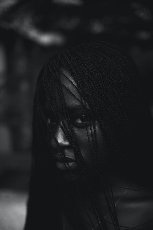 greyscale photo of woman staring at camera
