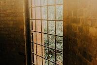 brown wooden frame glass panel door
