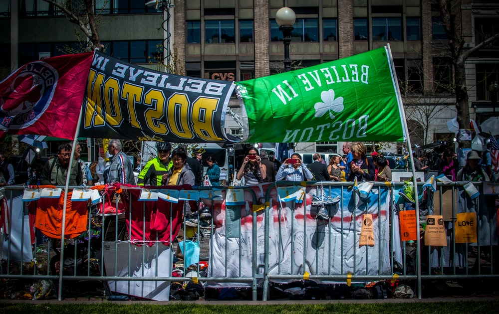 people standing in front of two banners
