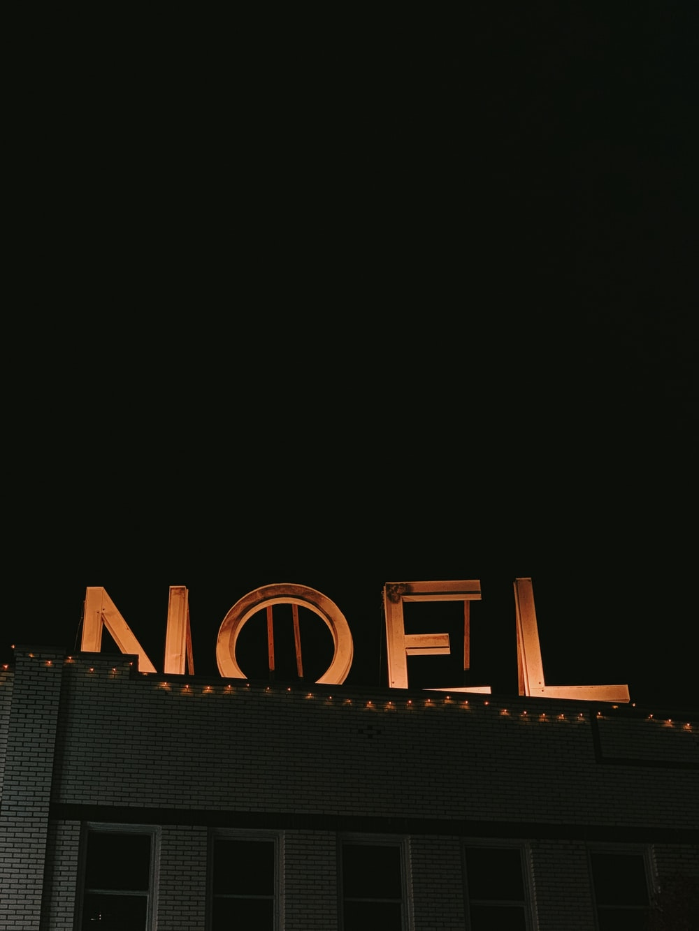 turned-on orange noel freestanding letters