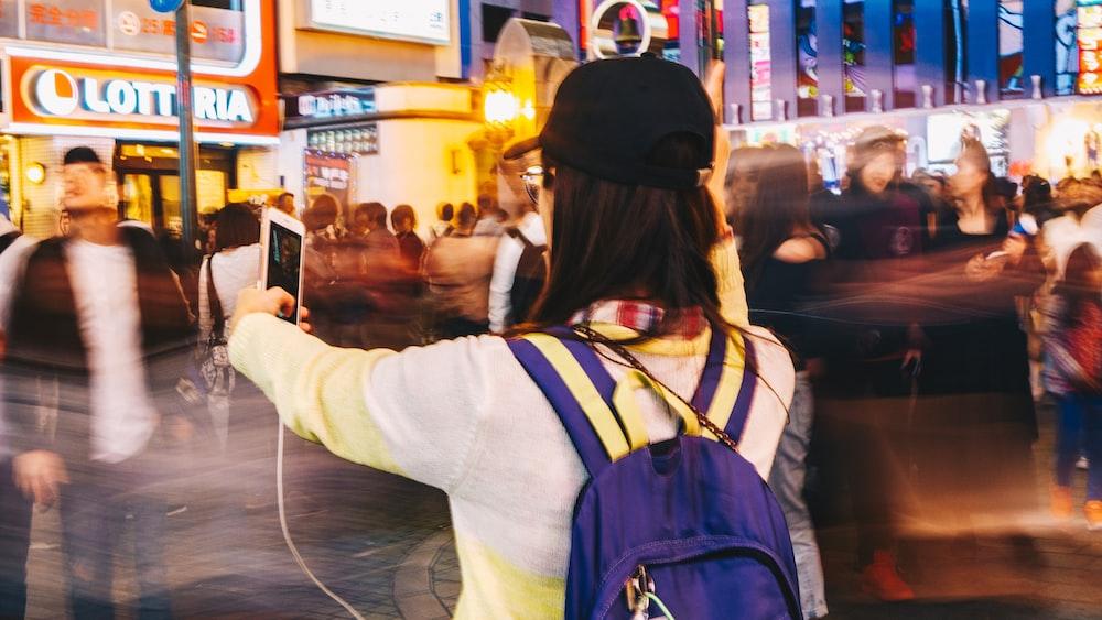 woman taking selfie photo near road