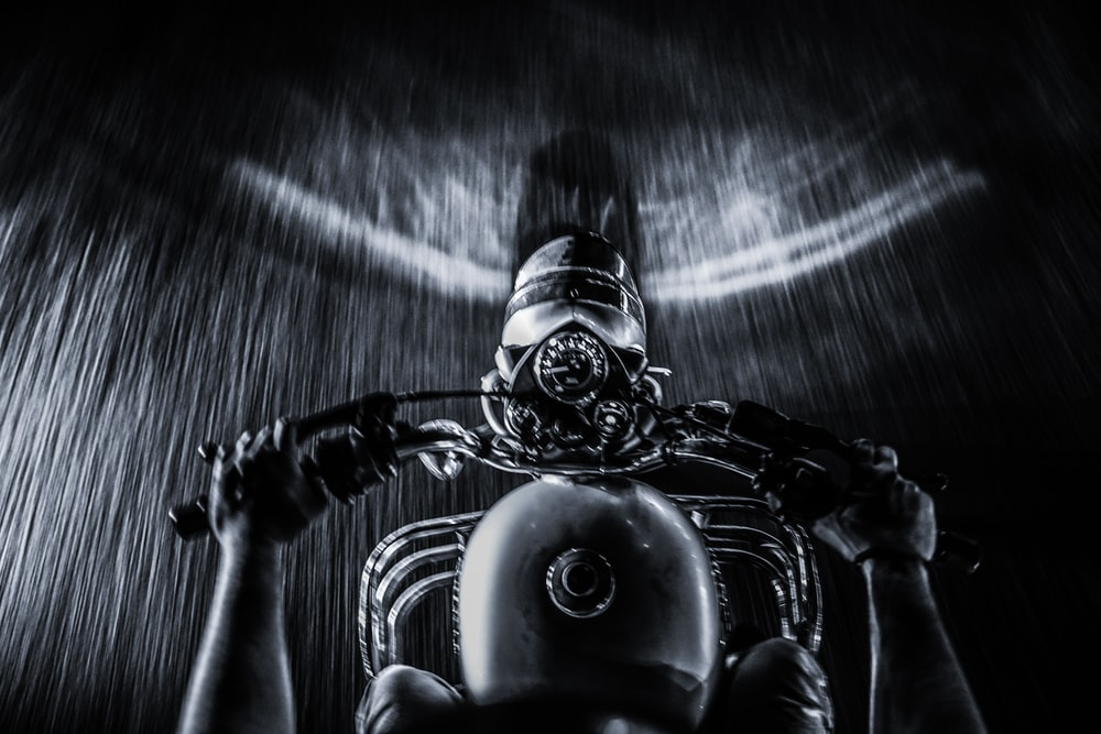 person riding motorcycle on road digital wallpaper