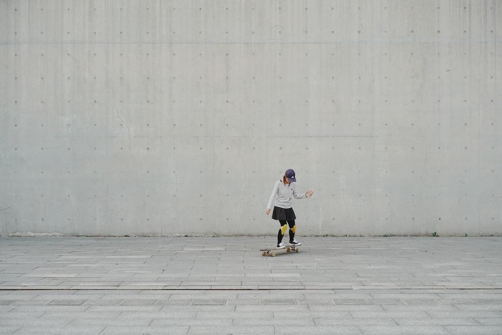woman riding on skateboard during daytime
