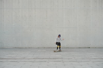 woman riding on skateboard during daytime wall zoom background