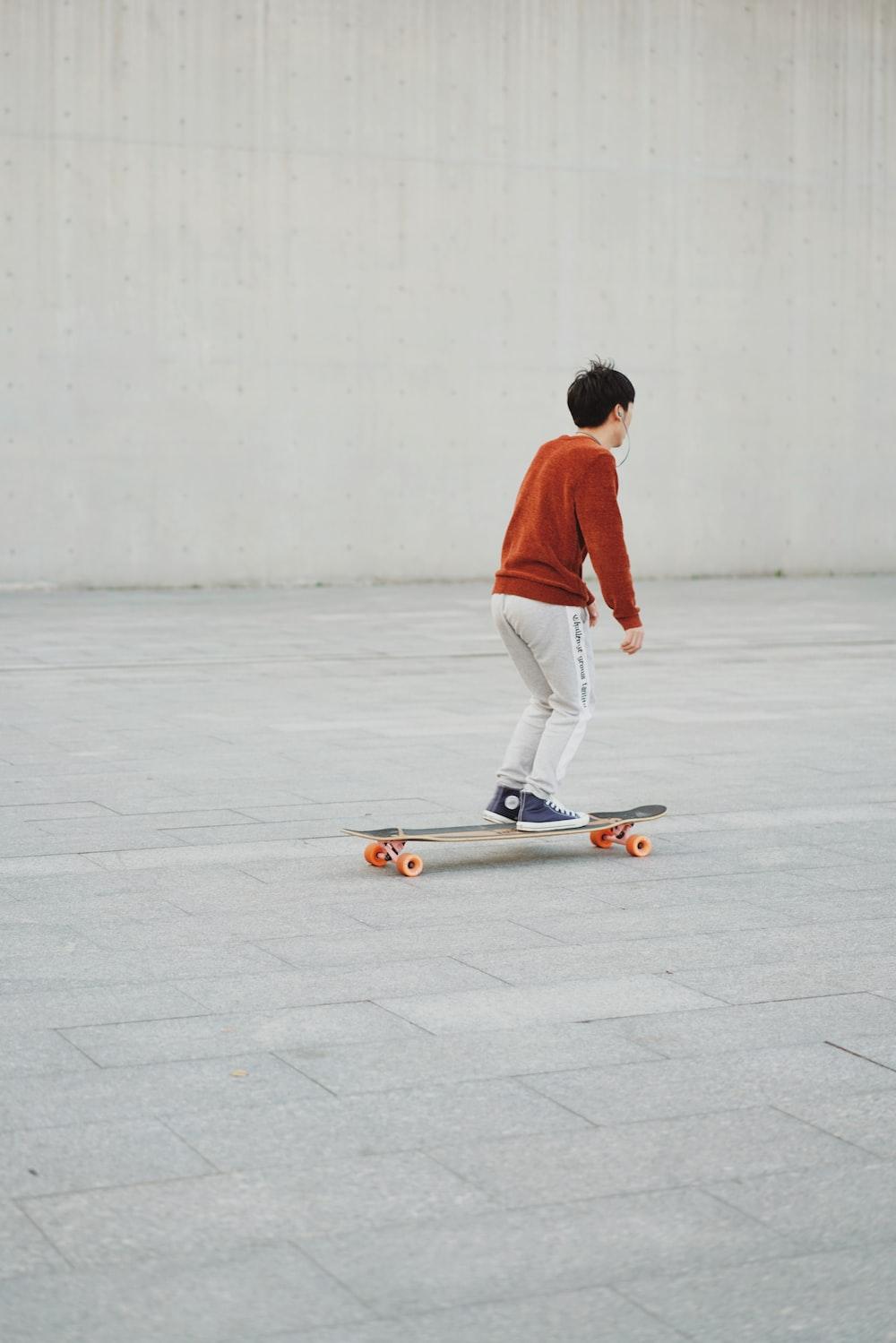man skating on pavement