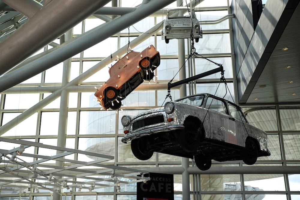 three cars hanged inside building