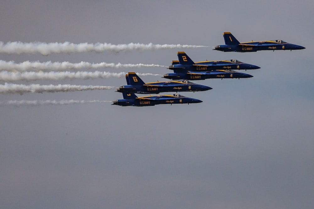 five blue fighter planes