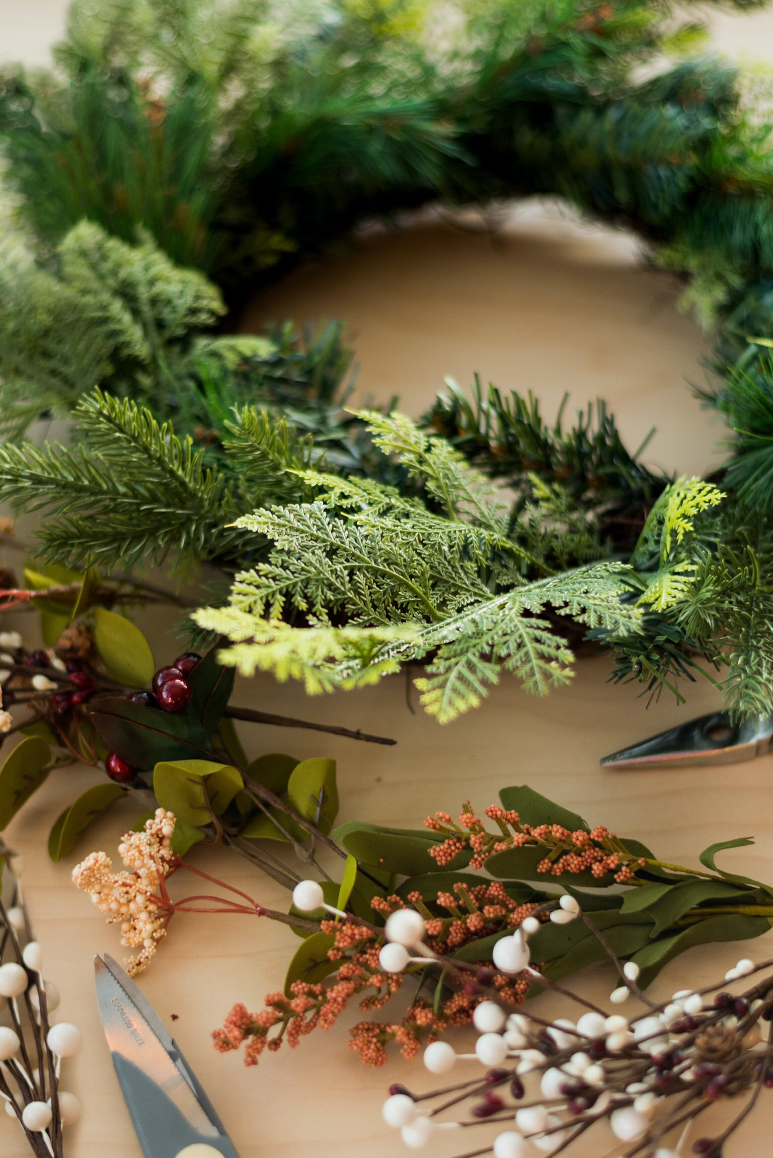 Christmas wreath on brown surface