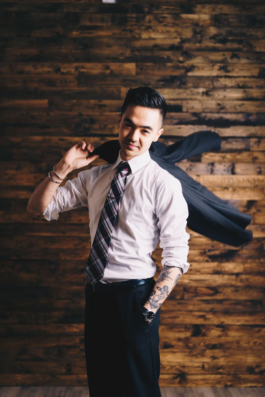 smiling man wearing suit standing