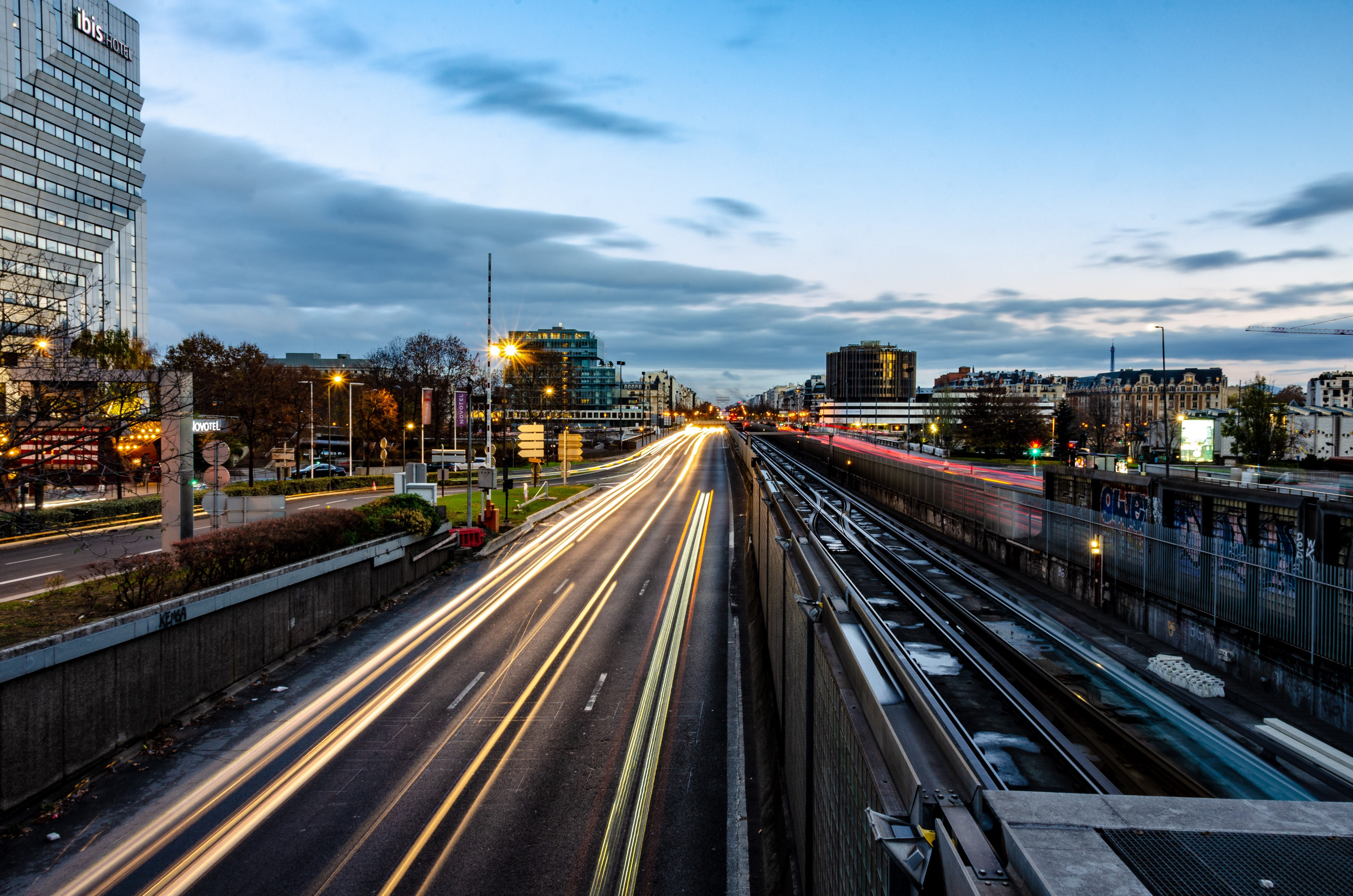 time-lapse photography of vehicle travelling on road during blue hour