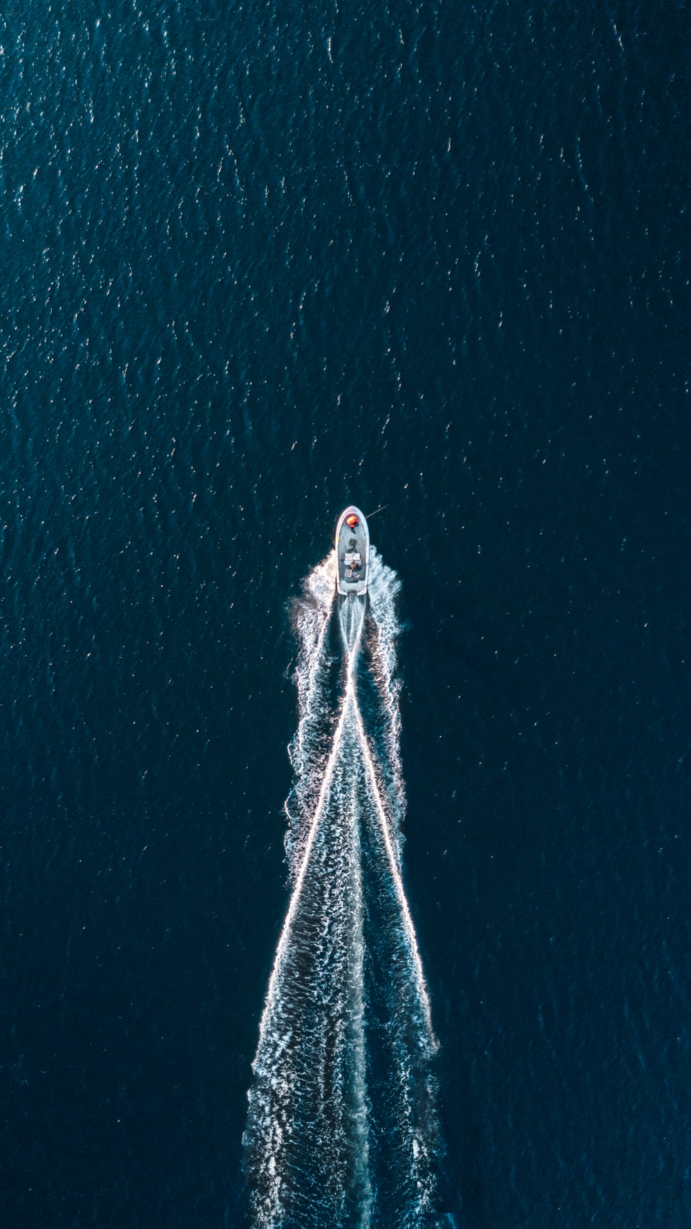 aerial photography of motorboat on sea
