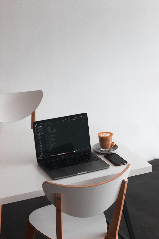 black laptop computer turned on