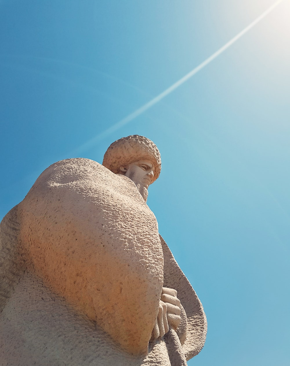 low angle photo of man's statue
