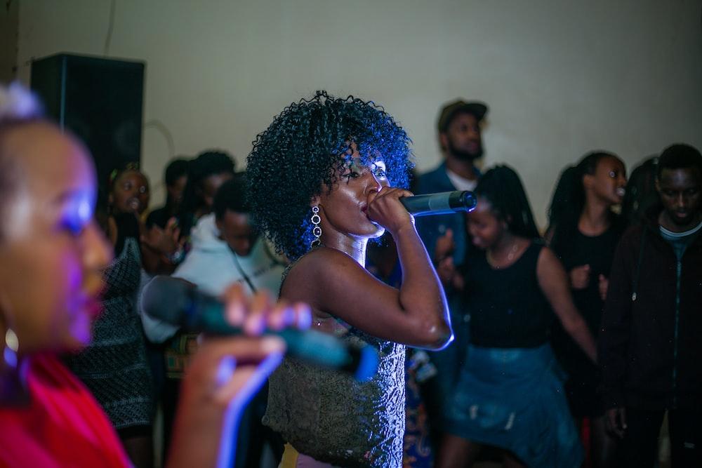 woman singing near people