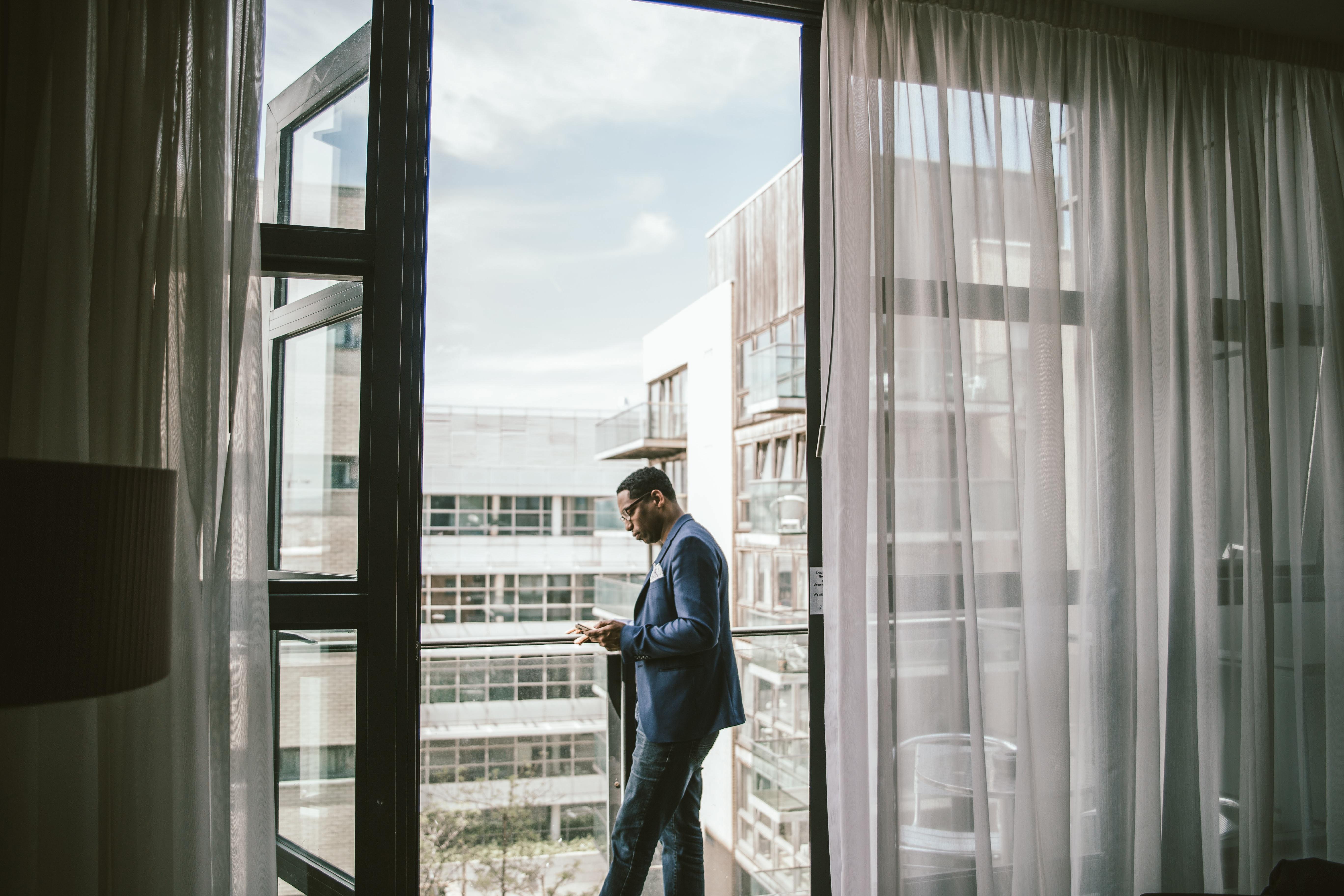 man in dress suit standing near door