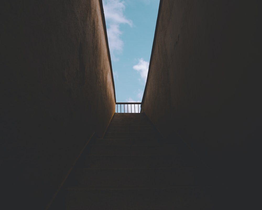 gray concrete stairs under blue sky