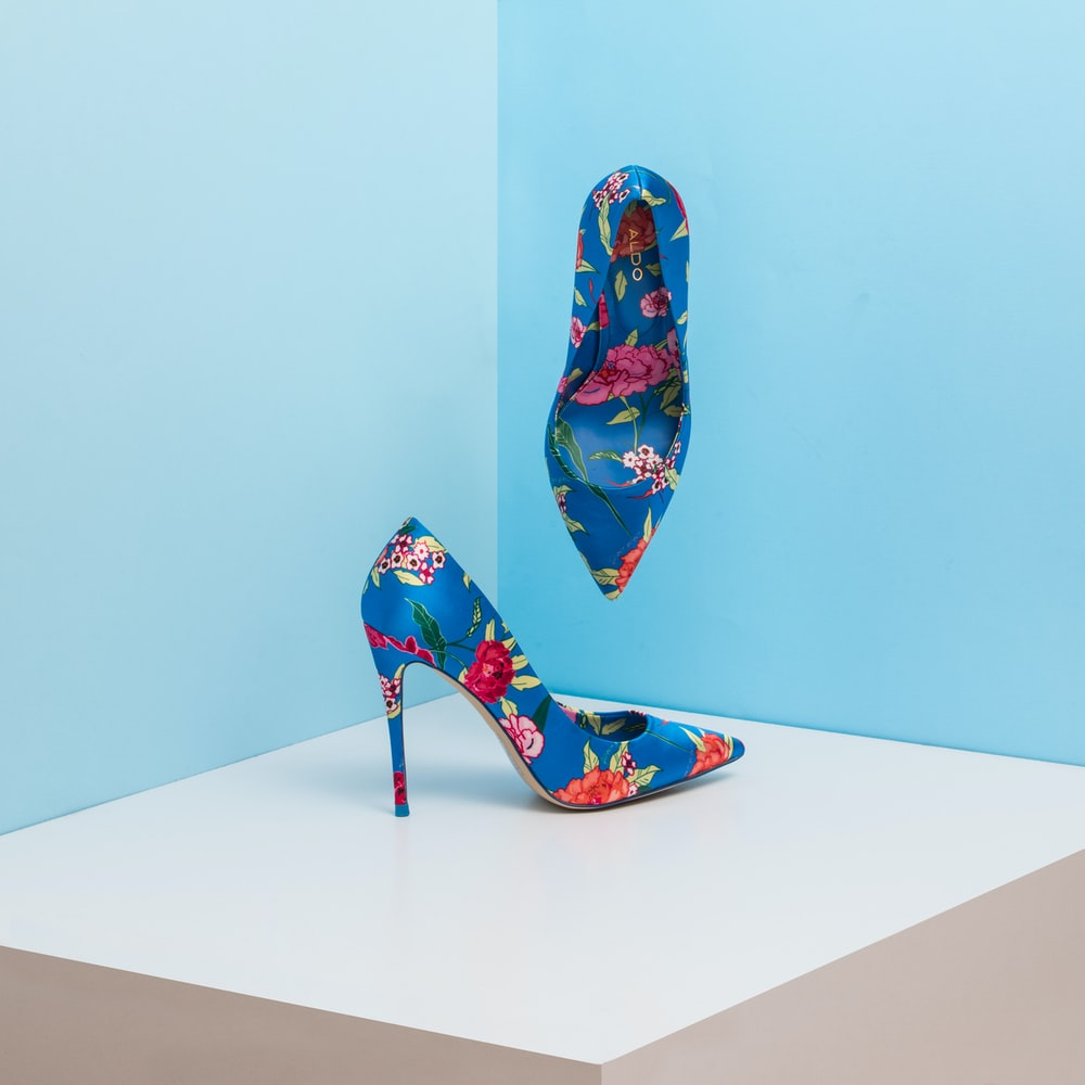 pair of blue-and-pink floral almond-toe pumps